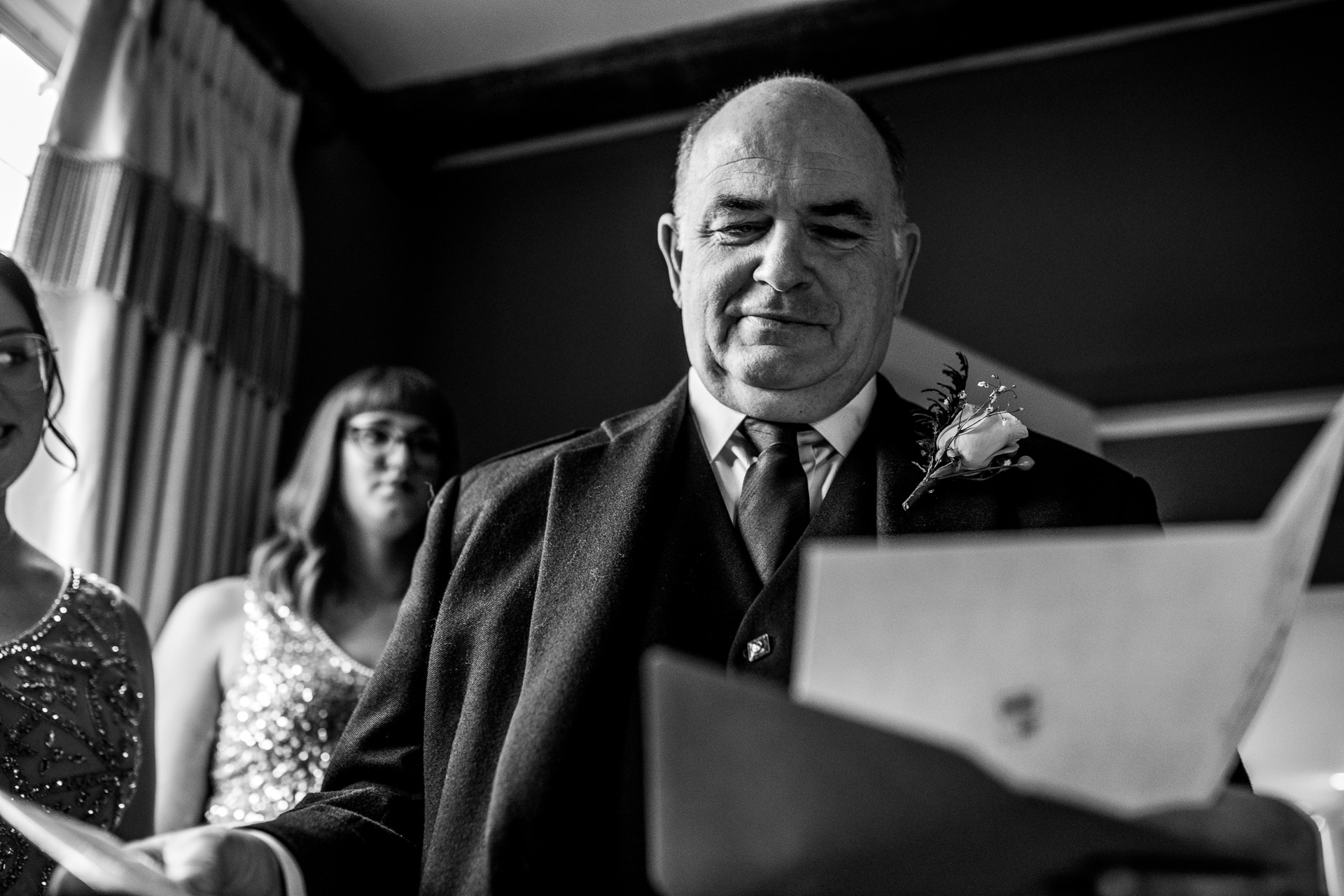 Father of the bride reading