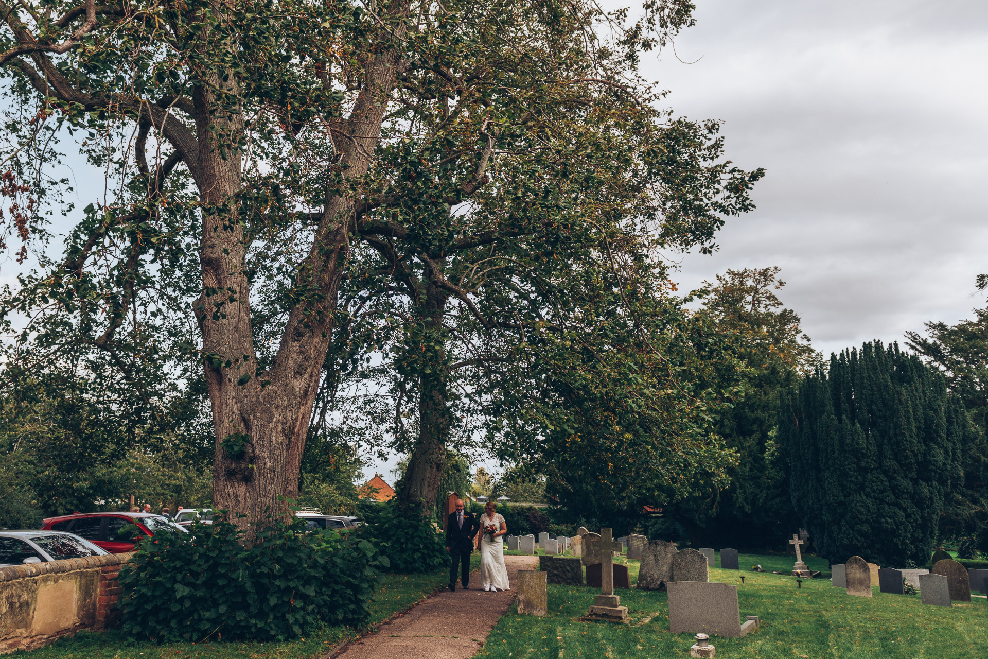 Bride and father arrive at Guests arriving at St Mary's Church Meppershall
