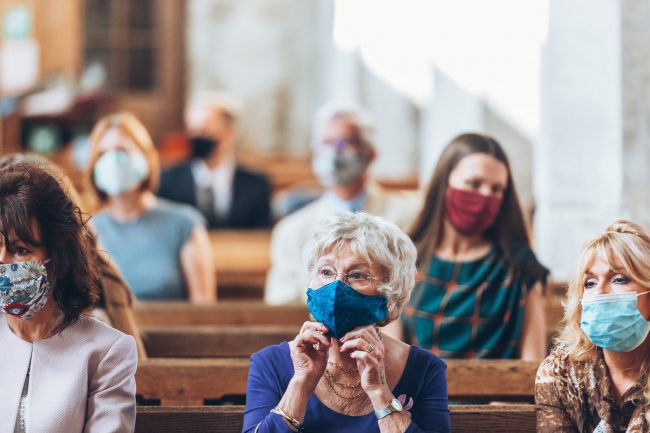 Guests wearing a mask during a service