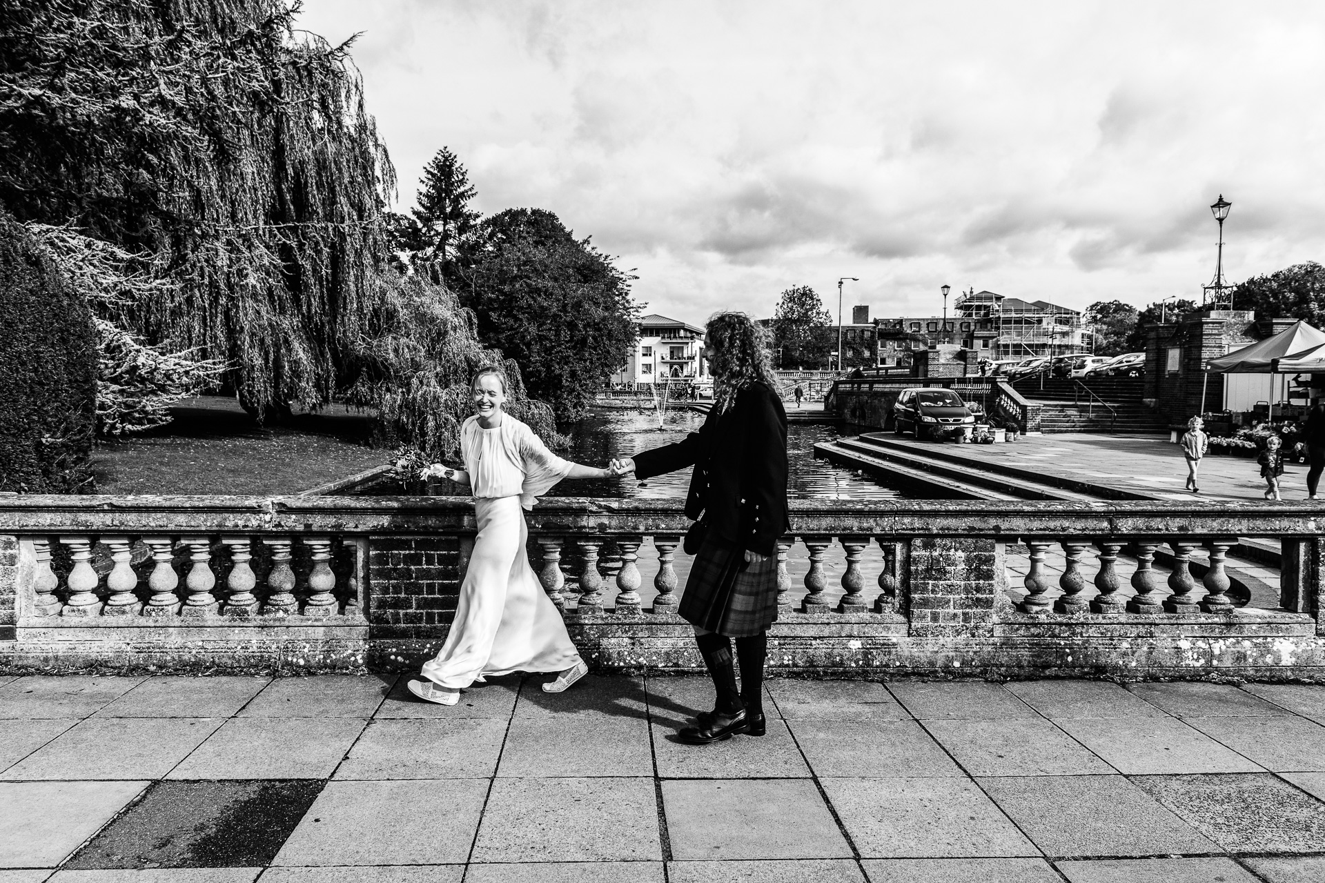Couple walk to their small wedding