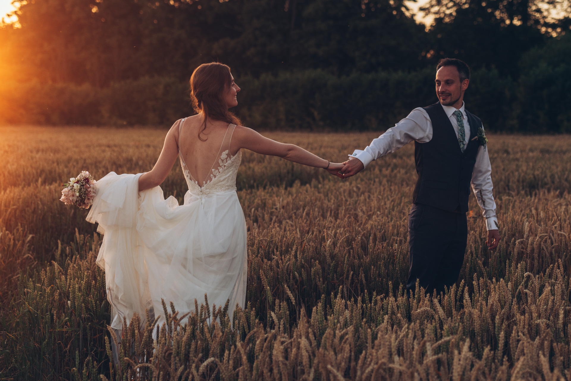 couple dancing in golden hours Farmhouse at Redcoats Wedding 107