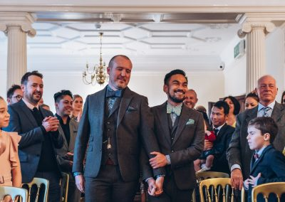 The grooms walking up the aisle