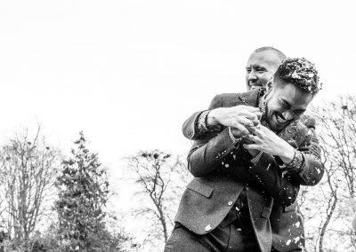 The grooms hugging
