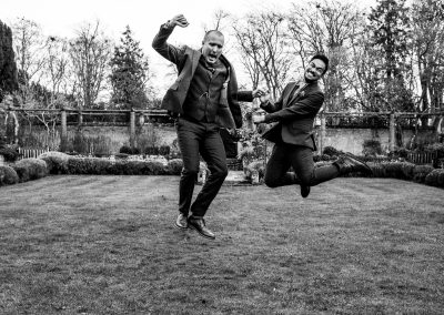 The grooms jumping in the air