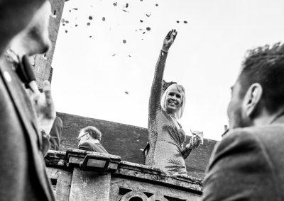 A female throwing confetti
