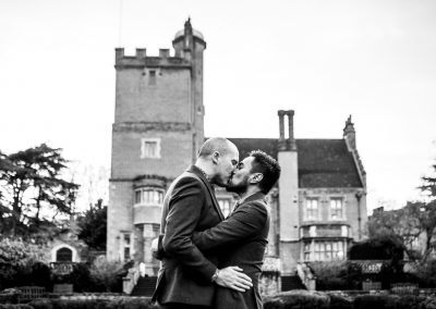 The grooms kissing outside their wedding venue