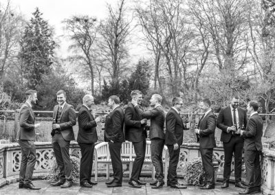Groom and groomsmen outside talking