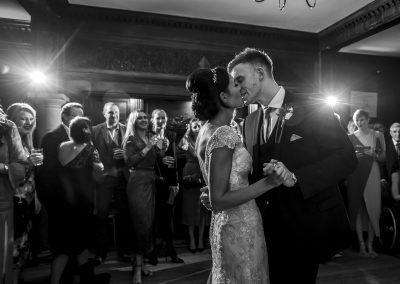 The bride and groom on the dance floor kissing